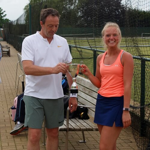 Winners of the Edmund-Loten Insprire mixed doubles tennis tournament hold the winners' trophy.